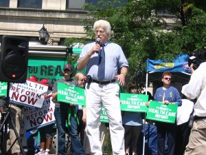 John speaking at rally for health care